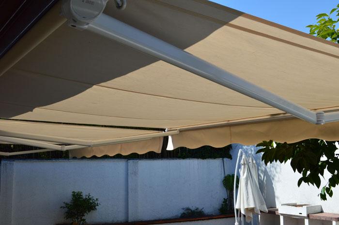 Toldo sombra vitacura solarsol for Roldanas para toldos